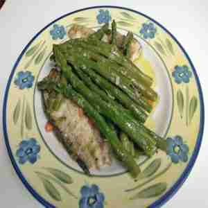 Bakedsea bream fillets with asparagus